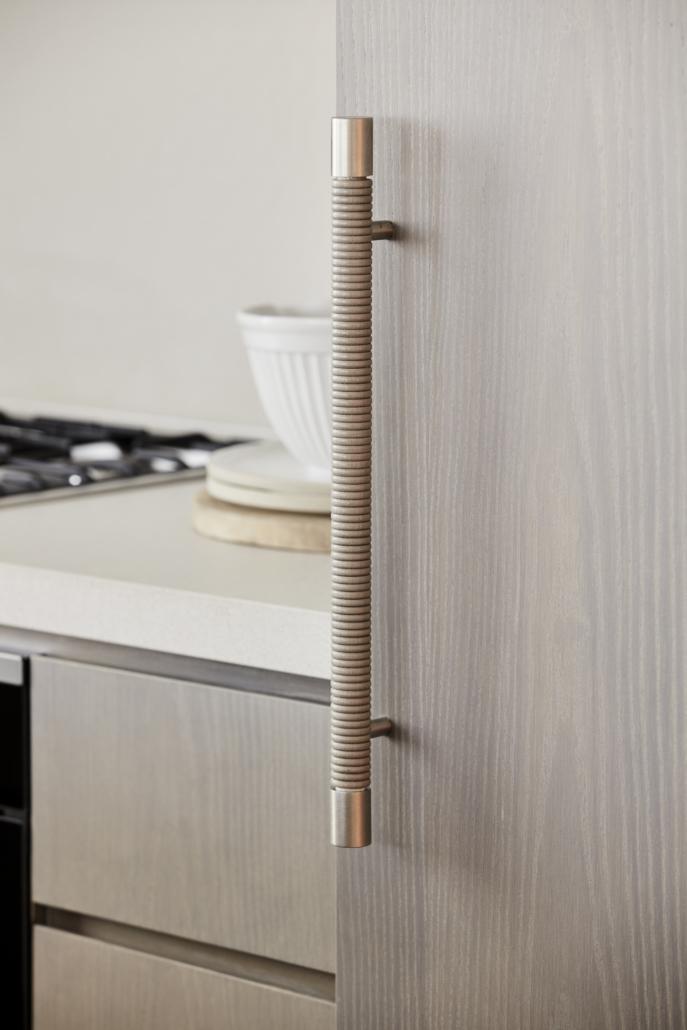Designer Doorware long rounded e=textured wooden handle