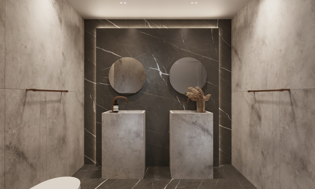 Specialty Hardware + Plumbing Showroom with double single pillar stone sings with brass faucets