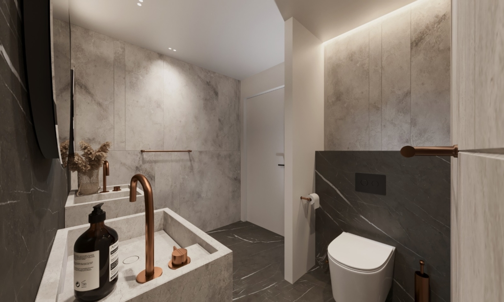 Specialty Hardware + Plumbing showroom of luxury bathroom with small modern toilet and brass accents