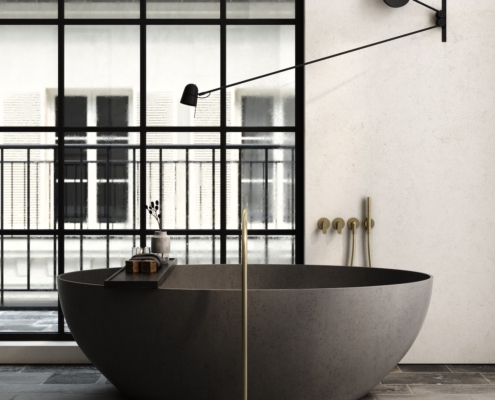 COCOON John Pawson gray bathtub with gold faucet